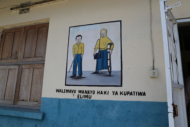 A painting on the wall at Kisiwandui primary school shows that the school welcomes students with disabilities. Credit: GPE/Chantal Rigaud
