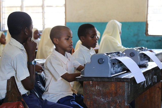 In the front row, two blind students use Braille machines during class. Kisiwandui primary school in Zanzibar. Credit: GPE/Chantal Rigaud