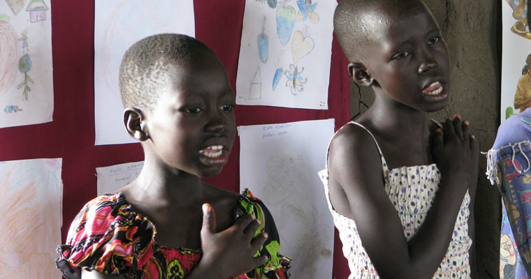 Two girls sing the national anthem of South Sudan at the Gudele West Basic School near Juba. South Sudan. Credit: GPE/David K. Bridges