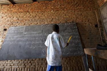 Reading at the blackboard. Chad. Credit: Educate a Child