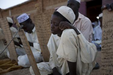Boys write on tablets in the open air in Chad. Credit: Educate a Child