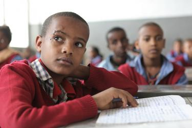 A school boy follows the lesson at Hidassie School. Addis Ababa, Ethiopia. Credit: GPE/Midastouch