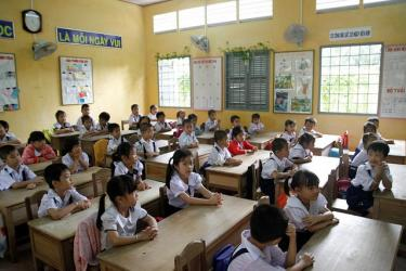 Children at their desks in a primary school in Vietnam. Credit: GPE/Koli Banik