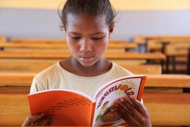 A girl reads a book. She attends the École Communautaire MASINDRAY in Madagascar. Credit: GPE/Carine Durand