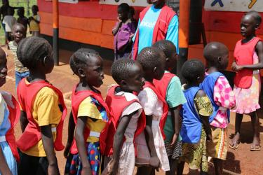 Children line up in front of their pre-school in Uganda. Credit: GPE/Chantal Rigaud