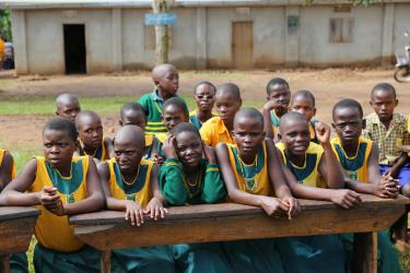 The school benches have been installed outside so that the students of Kabembe Primary School in Uganda can participate in the welcome ceremony. Credit: GPE/Chantal Rigaud