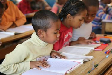 School children read from their books in a school in Madagascar. Credit: GPE/Carine Durand