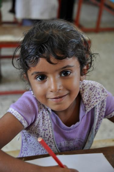 A Yemeni girl in school. Credit: Julien Harneis
