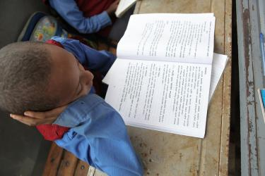 A boy reads in his notebook at Hidassi Primary School in Addis Ababa. Ethiopia. Credit: GPE/Midastouch