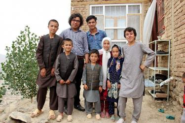 Asif and Shoaib outside with some of ROYA's students. Credit: ROYA team