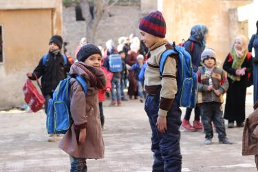 2 students outside the Kheir eddine Al-ASadi School in Aleppo. © UNICEF/UN051522/Al-Issa