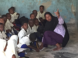 A teacher with her students at the Kijito Upele Primary School outside of Stonetown, Zanzibar
